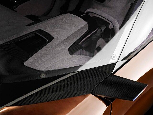 Design Peugeot Onyx - Porte extérieure en cuivre, planche de bord intérieure en bois